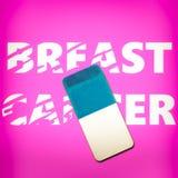 删掉词乳腺癌的橡皮擦 库存照片