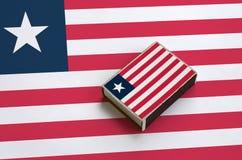 利比里亚旗子在一面大旗子说谎的火柴盒被生动描述 免版税库存图片