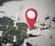 别针特写镜头在世界地图旅途旅行的 图库摄影