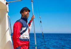 刮胡须水手人小船上尉盖帽的航行海 免版税库存照片