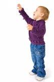 到达某事的婴孩逗人喜爱的女孩 免版税库存照片