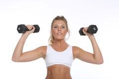 制定出和做健身活动的愉快的少妇 免版税库存图片