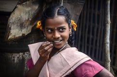 制服的美丽的微笑的女小学生 图库摄影