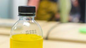 制造业日期和有效期在瓶浮出水面 免版税图库摄影