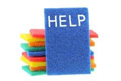 洗刷与词帮助的海绵在蓝色一个 免版税库存图片