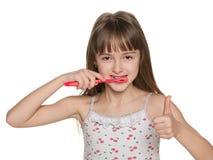 刷她的牙的女孩 库存图片
