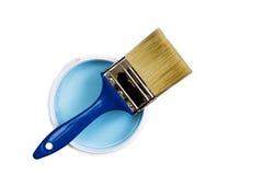 刷子和蓝色油漆瓶子与 库存照片