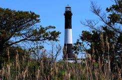 刷子围拢的火海岛灯塔 免版税库存图片