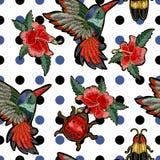 刺绣蜂鸟、木槿花、蝴蝶和瓢虫 库存照片