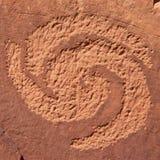 刻在岩石上的文字螺旋 免版税图库摄影