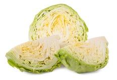 削减在白色背景隔绝的年轻圆白菜头 免版税图库摄影