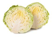 削减在白色背景隔绝的年轻圆白菜头 免版税库存照片