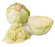 削减在白色背景隔绝的年轻圆白菜头 免版税库存图片