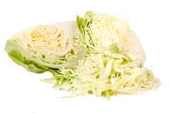 削减在白色背景隔绝的年轻圆白菜头 库存照片