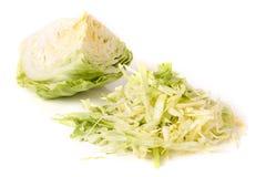 削减在白色背景隔绝的年轻圆白菜头 图库摄影