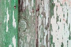 削皮在老被风化的纹理木头的纹理油漆-构造背景,老木板条的纹理表面 库存图片