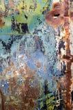 削皮油漆和生锈的老金属纹理 库存图片