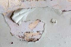 削皮被绘的墙壁特写镜头  免版税库存照片