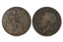 前化为十进位制英国便士硬币 图库摄影