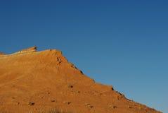 前阳光在Caineville,犹他附近的沙漠 库存照片