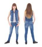 前面和后面观点的牛仔裤的逗人喜爱的十几岁的女孩给isolat穿衣 库存图片