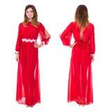 前面和后面观点的红色礼服孤立的年轻华美的妇女 库存图片