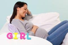 前面的孕妇女孩 免版税库存照片