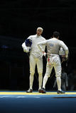 击剑者英里Chamley华森L和Gerek Meinhardt美国在里约2016年奥运会的人` s队箔竞争 库存图片