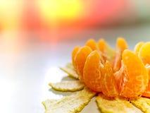 剥在正确的背景的橙色莲花锐利与红灯 免版税图库摄影