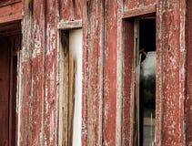 剥红色被绘的墙壁 库存图片