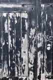 剥落蟒蛇的被破坏的, stratched和崩裂的黑油漆 免版税库存图片