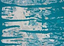 剥落水泥墙壁的蓝色油漆 库存照片