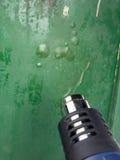 剥离油漆的热气枪 免版税库存照片