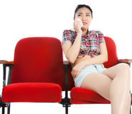 剧院孤立白色背景的可爱的亚裔女孩20s 免版税库存照片
