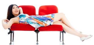 剧院孤立白色背景的可爱的亚裔女孩20s 免版税库存图片