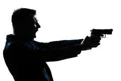 剪影与枪的人纵向 库存照片