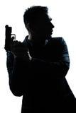 剪影与枪的人纵向 免版税库存图片