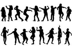 剪影儿童跳舞 免版税库存图片
