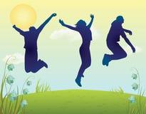 剪影双人和妇女跳跃 免版税库存照片