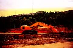剪影反向铲或挖掘机 库存照片