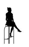 剪影坐的妇女 图库摄影