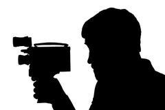剪影有胡子的人电影摄影机 图库摄影