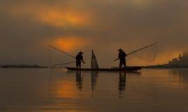 剪影渔夫 图库摄影