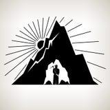 剪影矿工和山 库存照片
