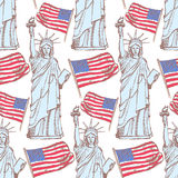 剪影自由女神像和旗子,无缝的样式 库存照片