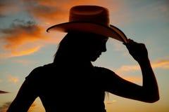 剪影西部妇女帽子技巧关闭 免版税库存照片