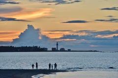 剪影Metis一朵云彩的灯塔和珠穆琅玛在日落的 库存照片