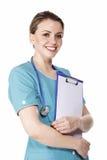 剪贴板医生女性藏品俏丽微笑 免版税图库摄影