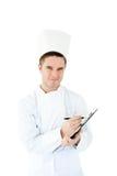 剪贴板厨师快乐的男性文字年轻人 库存图片