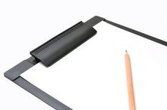 剪贴板和铅笔 图库摄影